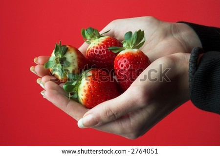 Strawberry in hand.