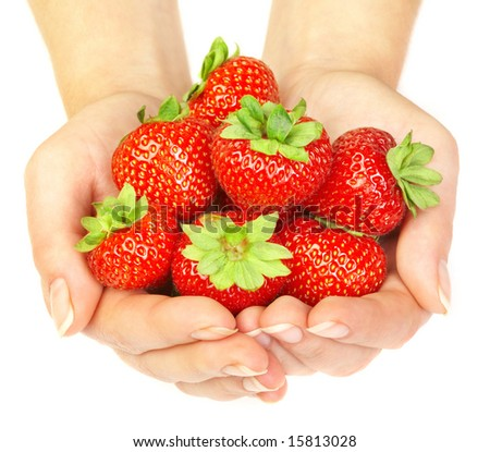 Strawberry in hands on a white background