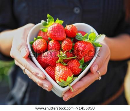 strawberry in heart shape bowl