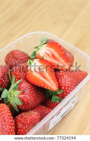 strawberry in plastic