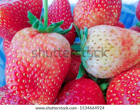 Strawberry is a fruit that has a sweet and sour taste.