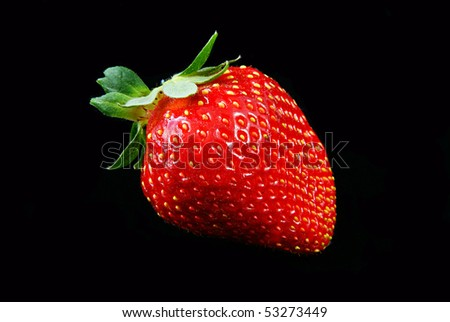 Strawberry isolated on black background.
