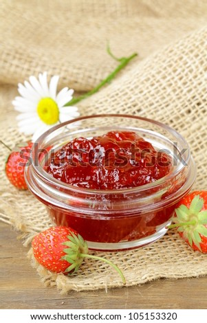 strawberry jam and fresh berries on the table