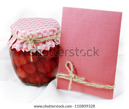 Strawberry jam in a glass  jar with a card.