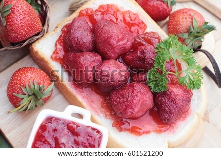 Strawberry jam with slice of bread delicious #601521200