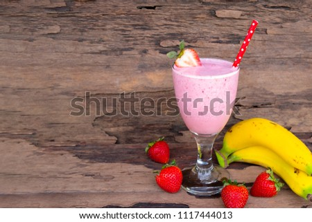 Stock Photo strawberry mix banana  smoothies juice,beverage healthy the taste yummy In glass,drink episode morning on wooden background.