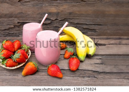 Stock Photo strawberry mix banana  smoothies red colorful fruit juice milkshake blend beverage healthy high protein the taste yummy In glass,drink episode morning on wood background.