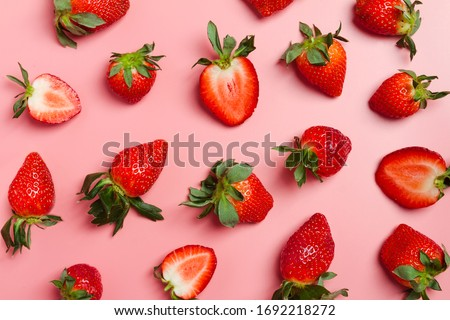 Strawberry on pink background, top view. Berries pattern. Strawberry flat lay on  pink background.