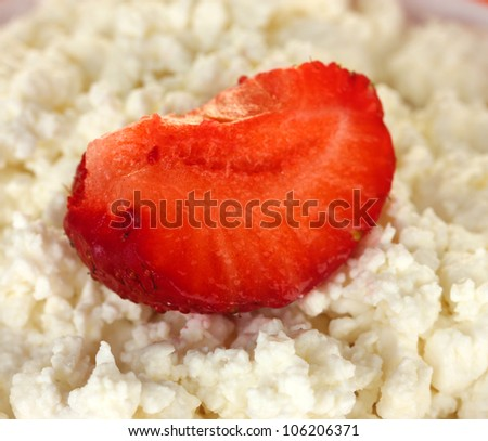 Strawberry on the cottage cheese close-up
