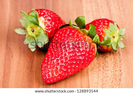 Strawberry over wooden background. - stock photo
