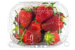 Strawberry package isolated on a white background with a clipping path. View from top. Supermarket shop plastic box container with fresh sweet fruits.
