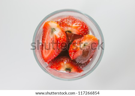 Strawberry pieces in glass top view