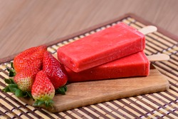 Strawberry Popsicle, Ice Cream Bar, Mexican Style Popsicle on a Wooden Table, Paleta Mexicana