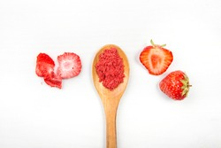 Strawberry powder made of freeze dried strawberries for sprinkle. Flavor and color ingredient for food. Top view, white minimal background, copy space. Great source of vitamin C and iron.