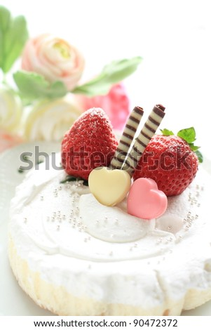 Strawberry short cake with heart shape chocolate