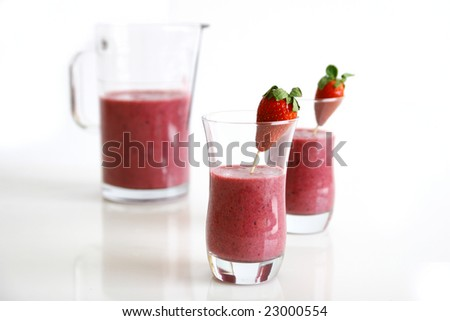 Strawberry smoothie and pitcher
