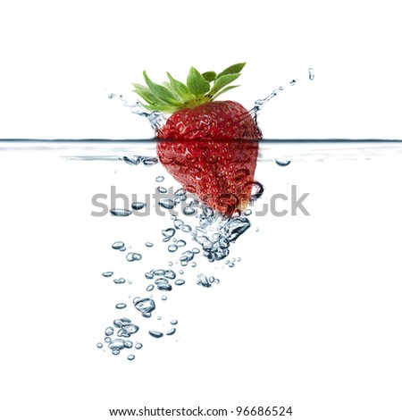 strawberry splash in transparent water, on white background