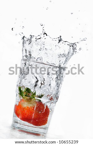 Strawberry splash into glass tilted right