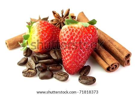 Strawberry with coffee, anise and cinnamon rods on a white background