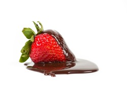 Strawberry with dripped chocolate syrup isolated on a white background