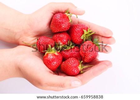 strawberrys in hand #659958838