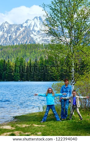 Strbske Pleso spring view with mountain lake and family  (Slovakia)