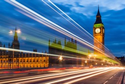 Streaks from buses, Westminster Bridge and Houses of Parliament at night, London, England