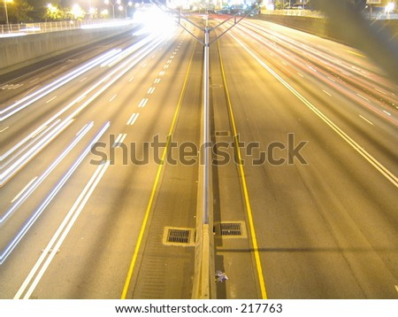 Streaks of light from cars driving down the highway