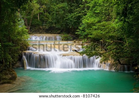 Stream and water cascades in the tropical forest of Erawan National Park, Kanchanaburi province, Thailand.