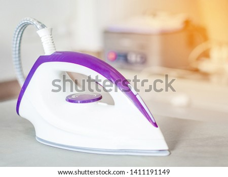 Stream iron housework ironed electric tool clean on table in the room ,Household duties, taking care of clothes concept.