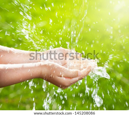 Stream Of Clean Water Pouring Into Children\'S Hands.