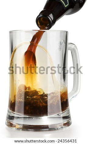 Stream of dark alcohol beer pouring into a glass from bottle with froth isolated over white background.