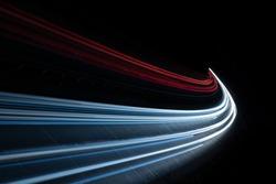 Stream of light trails on motorway at night