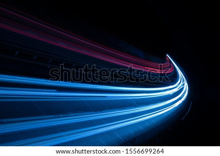 Stream of light trails on motorway at night stock photo