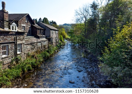 Stream running through Grasmere in the lakes district in Cumbria, UK. #1157310628