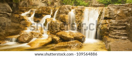 stream waterfall in the mountain