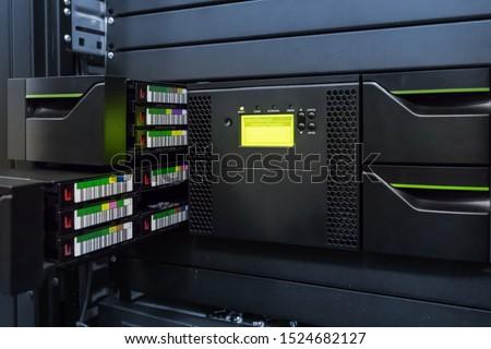 streamer, tape library for data backup in the server rack in the datacenter. #1524682127