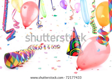Streamers,balloons and party hat in confetti rain.