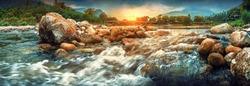 Streaming water and rocks in sunset at a small river , Ban Khiri Wong village, Nakhon Si Thammarat, Thailand, landscape and panorama shot.