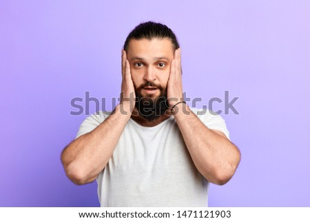 streeful terrified bearded man keeping mouth wide open, put hands on cheeks. close up portrait. isolted blue background. emotion and feeling . Oh, my God #1471121903