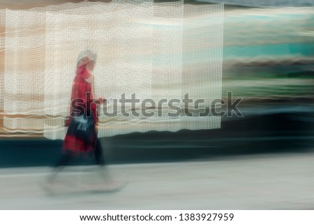 Street abstract - long exposure of a pedestrian walking along the high street - intentional camera shake to introduce an impressionistic effect and light trails - creative filter applied ストックフォト ©