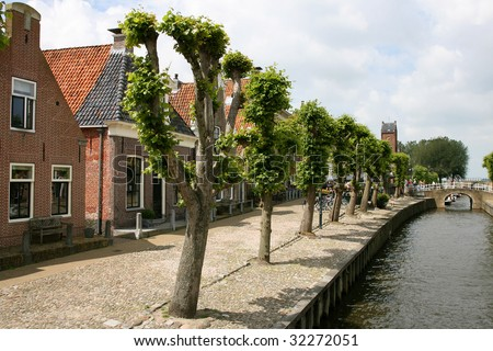 Street and a bridge by a canal in Sloten(Holland)