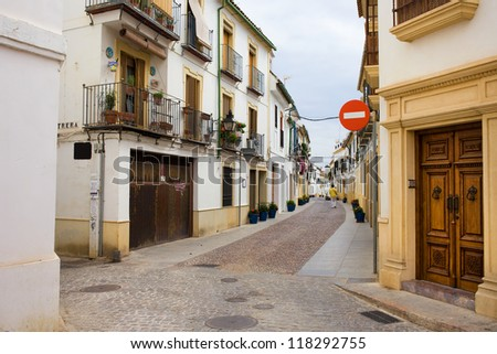 Street and traditional apartment houses in the Old Town of Cordoba, Andalusia, Spain.