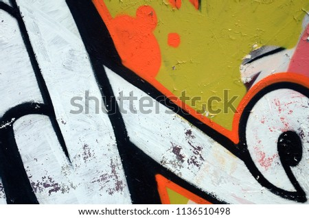 Street art. Abstract background image of a fragment of a colored graffiti painting in white and orange tones #1136510498