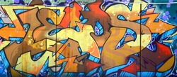 Street art. Abstract background image of a full completed graffiti painting in beige and orange tones