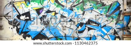 Street art. Abstract background image of a full completed graffiti painting in chrome and blue tones