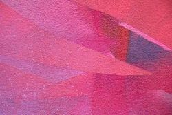 Street art. Colorful graffiti on the wall. Detail of a graffiti. Red abstract background painting