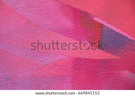 Street art. Colorful graffiti on the wall. Detail of a graffiti. Red abstract background painting #669841153