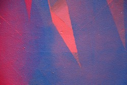 Street art. Colorful graffiti on the wall. Fragment for background. Vivid color. Abstract graffiti on the wall. Pink and blue color