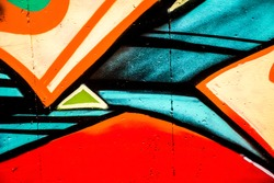 Street art - graffiti painting on the wall. Colorful shapes.  Abstract design.